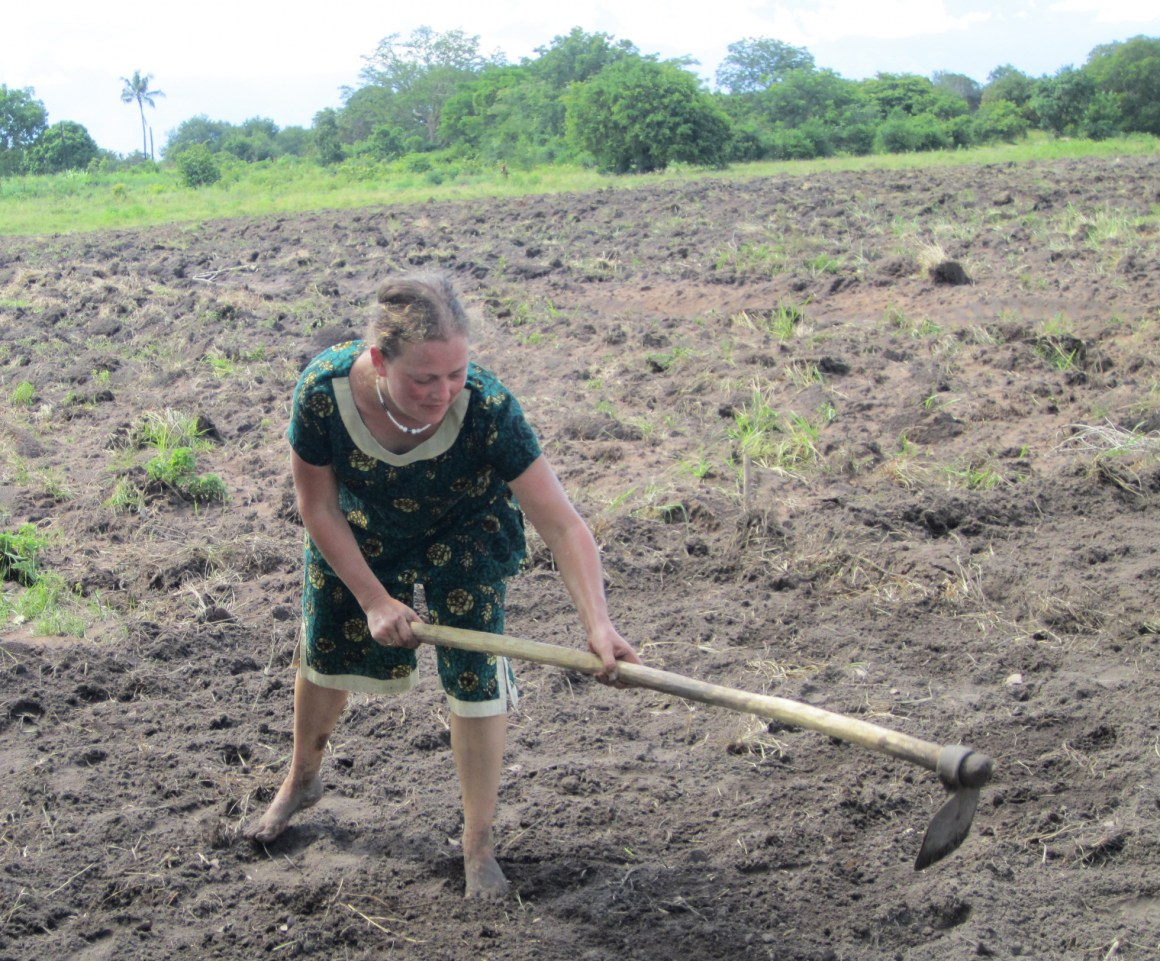 Jennifer Joy West preparing an agricultural experimentation plot to test out local and improved rice varieties and planting methods in Lungo village, Tanzania.