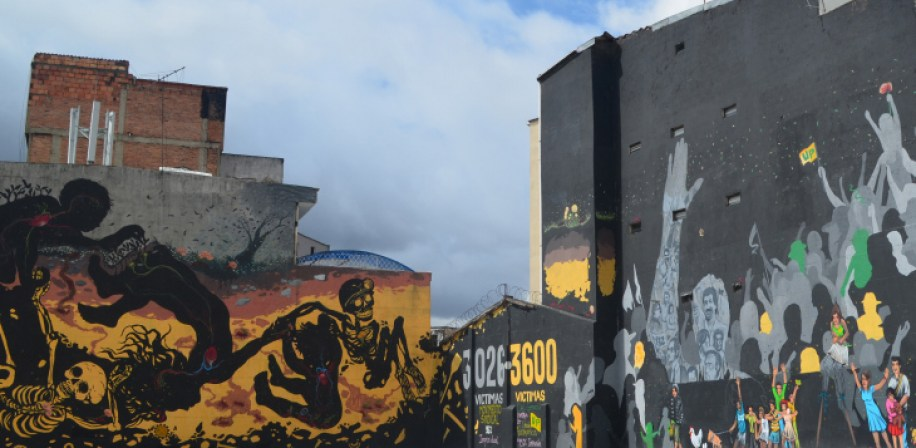 Mural in Bogota depicting the relationship between mining and conflict in Colombia.