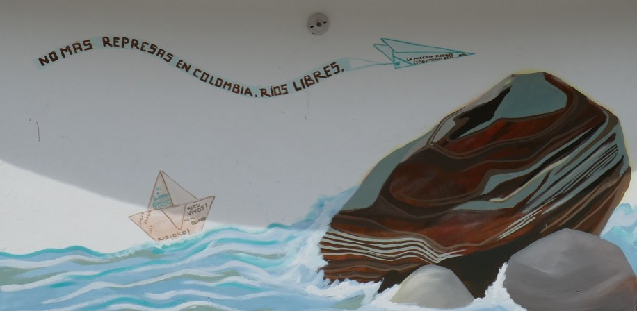 Street art in the town square of Rioloro, closely located to the El Quimbo dam. The words written in Spanish translate to 'No more dams in Colombia. Free Rivers'.