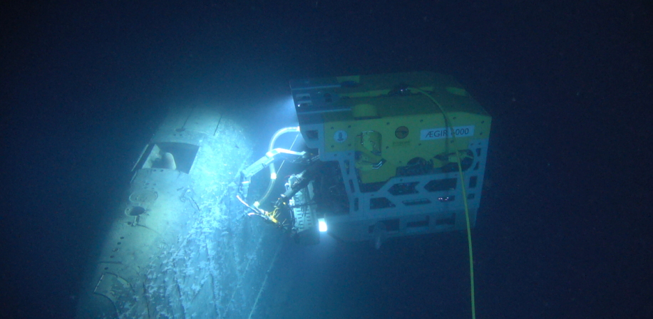 "ROV ""Ægir 6000"" is working by the submarine wreck at the depth of almost 1700 m"