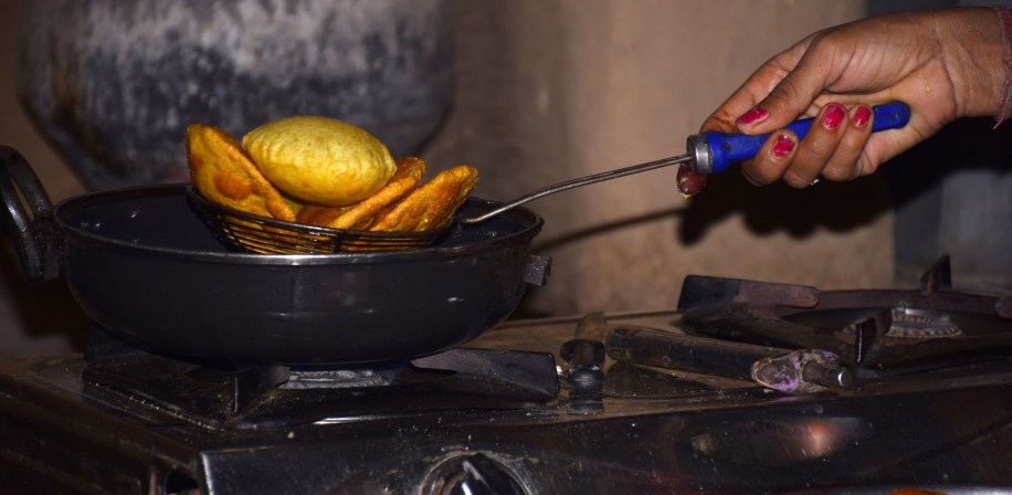 Cooking on an LPG gas stove.
